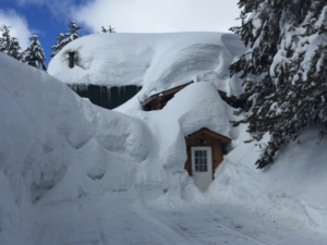 heavy snow load on the roof and surrounding a house